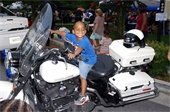Child on motorcycle at National Night Out