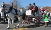 Santa riding in horse drawn carriage
