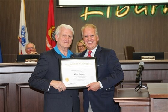 Council member Tim Dunn being presented the Certificate of Excellence by Mayor Johnny Crist