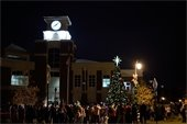 People standing around lit tree at Lilburn City Hall