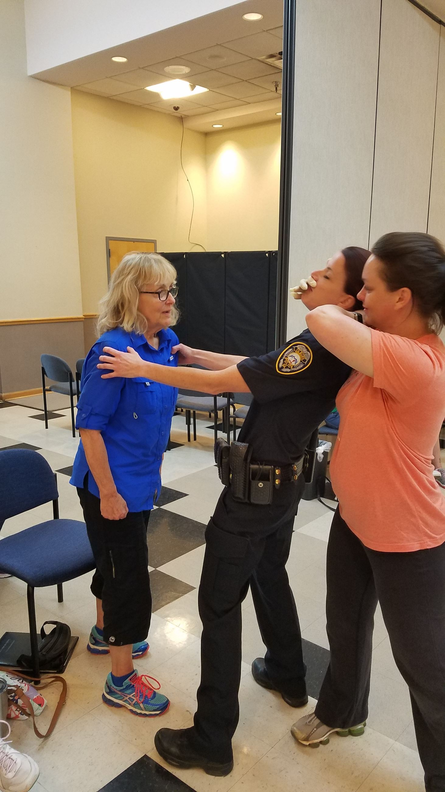 Women learn to defend off an assailant's attack.