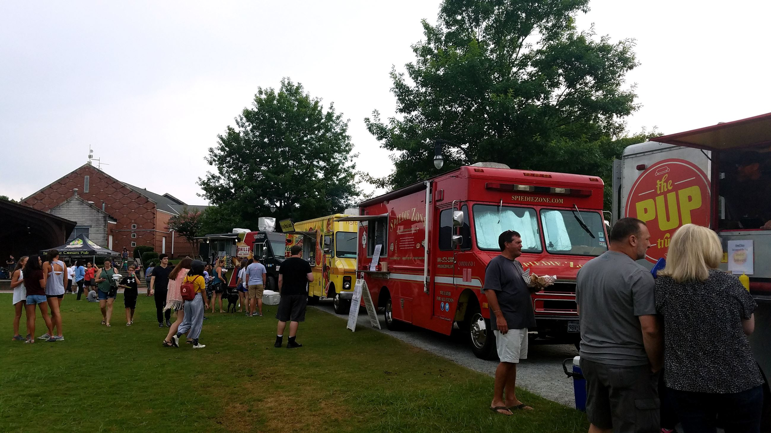 People and trucks at Lilburn Food Truck Tuesday